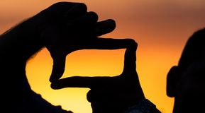 Fotografii ramowa sylwetka przy zmierzchem Obraz Royalty Free