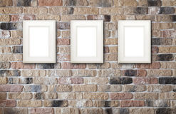 Fotografii ramy na ściana z cegieł Zdjęcia Royalty Free