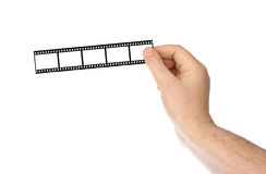 Fotografische film in handen Royalty-vrije Stock Foto's