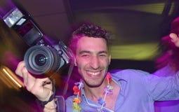 Fotografo ad un partito Fotografie Stock Libere da Diritti