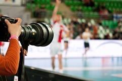 Fotografo alla partita di pallavolo Fotografie Stock