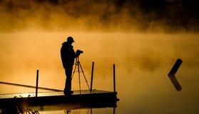 Fotografo Capture Sunrise Mist fotografia stock