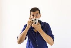 Fotografo che pensa al suo nuovo istante fotografia stock