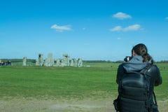 Fotografo che prende le foto del paesaggio Immagine Stock