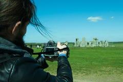 Fotografo che prende le foto del paesaggio Immagini Stock