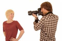 Fotografo con il modello Fotografia Stock