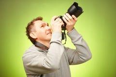 Fotografo con la macchina fotografica Immagine Stock