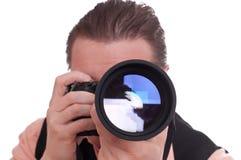 Fotografo con la macchina fotografica reflex e l'obiettivo di telephoto Immagini Stock Libere da Diritti