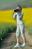 Fotografo della donna professionale Immagini Stock