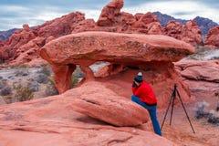 Fotografo della roccia del piano Fotografia Stock