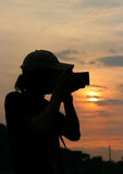 Fotografo della siluetta Fotografia Stock