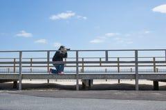 Fotografo della spiaggia fotografia stock