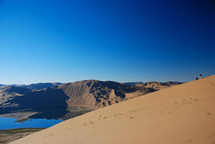 Fotografo in deserto fotografia stock