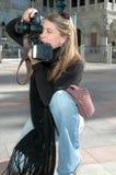 Fotografo lavorante Fotografia Stock