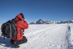 Fotografo nelle alpi Fotografia Stock