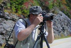 Fotografo professionista su un tiro di foto Fotografia Stock