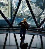 Fotografo, 30 st Mary Axe, Londra Immagini Stock