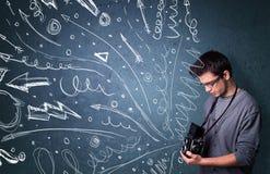 Fotografschießenbilder, während gezeichnete die Energiehand zeichnet Stockbilder