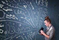 Fotografschießenbilder, während gezeichnete die Energiehand zeichnet Lizenzfreies Stockbild