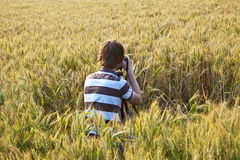 Fotographer in corn field Royalty Free Stock Image