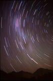 Fotographia lunga di esposizione del cielo notturno Immagine Stock