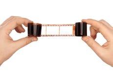 Fotographischer Film in den Händen Stockfotografie