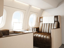 Fotoinnenraum des privaten Luxusflugzeuges Leerer Lederstuhl, moderne generische Designlaptoptabelle Leerer weißer Schirm Lizenzfreies Stockfoto