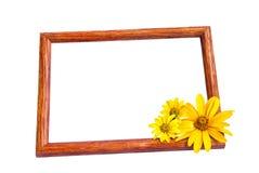 Fotokader en gele bloemen Stock Fotografie