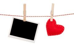 Fotokader en van de valentijnskaartendag stuk speelgoed hart Stock Foto