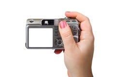 Fotokamera in der Hand lizenzfreie stockbilder