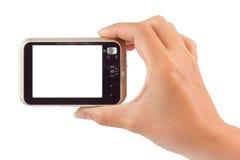 Fotokamera in der Hand stockbild
