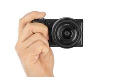 Fotokamera in der Hand lizenzfreies stockfoto