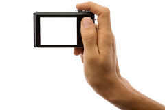 Fotokamera in der Hand getrennt auf weißem Hintergrund Lizenzfreie Stockbilder
