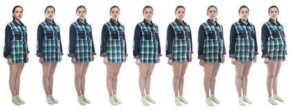 Fotomädchen während der Schwangerschaft im karierten Hemd Lizenzfreie Stockbilder