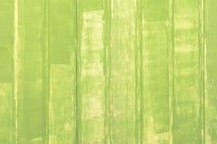 Fotoplanken mit Farbe eine blasse e-grün Farbe Die Wand wird von den glatten gemalten Streifen hergestellt Leerer Hintergrund mit Stockfotos