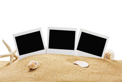 Fotorahmen auf dem Meersand lokalisiert Stockfotos