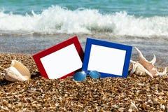 Fotorahmen auf dem Strand, Fotografie auf dem Strand, Seeoberteile, Lizenzfreie Stockfotos