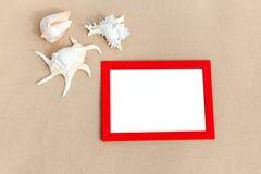 Fotorahmen auf Sand Lizenzfreies Stockbild