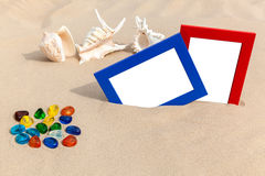 Fotorahmen auf Sand Lizenzfreies Stockfoto