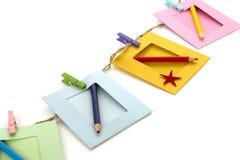 Fotorahmen mit Bleistift lokalisiertem Weiß Lizenzfreies Stockfoto