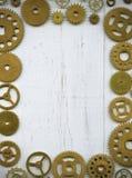 Fotoram, från ett stort antal klockakugghjul på en wh Arkivbilder