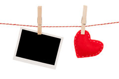 Fotoram och hjärta för valentindagleksak Arkivfoto