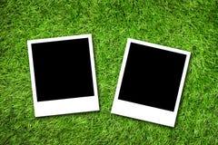 Fotoram på gräs Arkivfoton