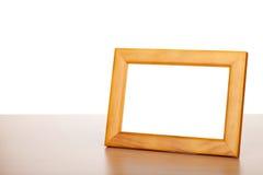 Fotoram på den wood tabellen Royaltyfria Bilder