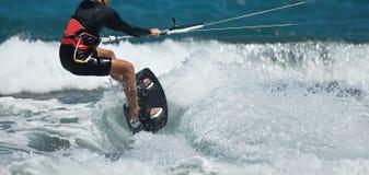 Fotos da ação de Kitesurfing Kiteboarding Fotos de Stock