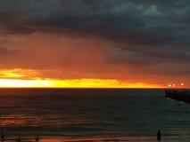 Fotos de la puesta del sol de la playa de Noarlunga del puerto Imagen de archivo libre de regalías