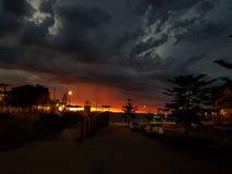 Fotos de la puesta del sol de la playa de Noarlunga del puerto Imagenes de archivo