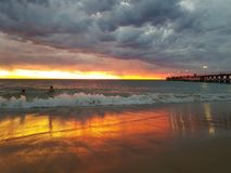Fotos de la puesta del sol de la playa de Noarlunga del puerto Imágenes de archivo libres de regalías