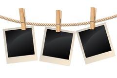 Fotos, die an einer Wäscheleine hängen Lizenzfreie Stockfotografie