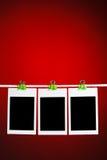 Fotos en blanco en fondo rojo Imagen de archivo libre de regalías